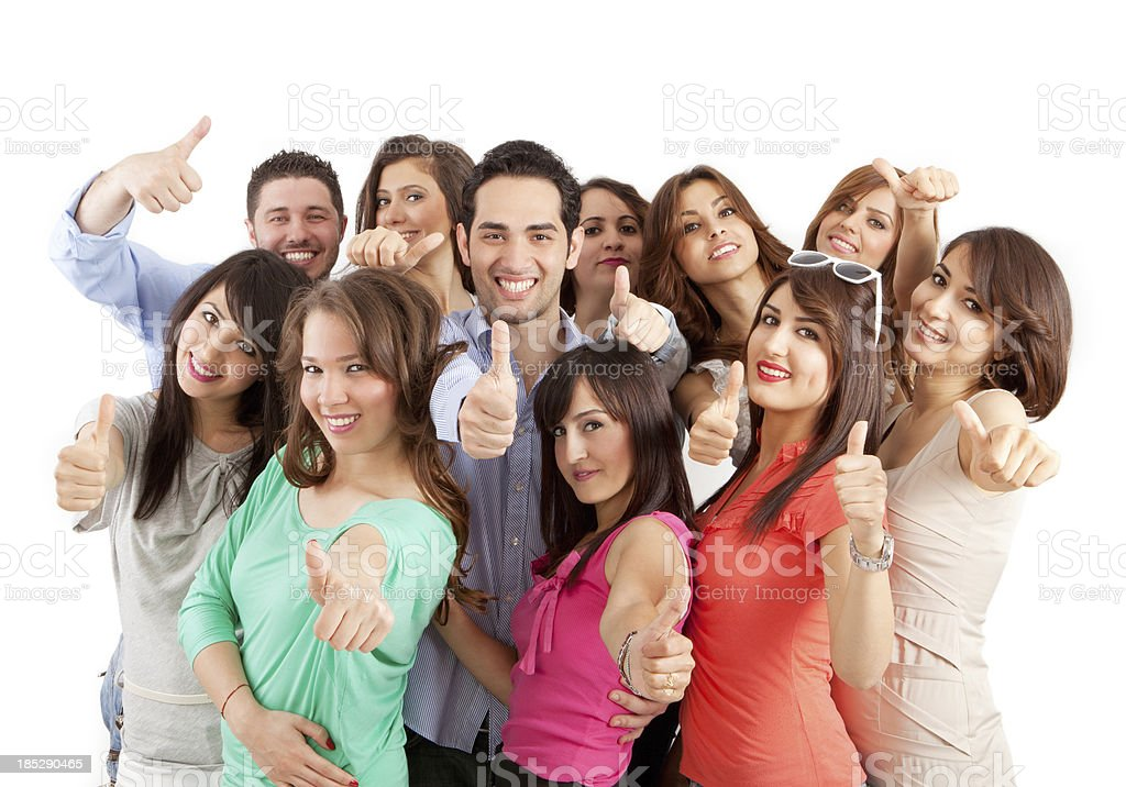 Group of young people showing thumbs up royalty-free stock photo