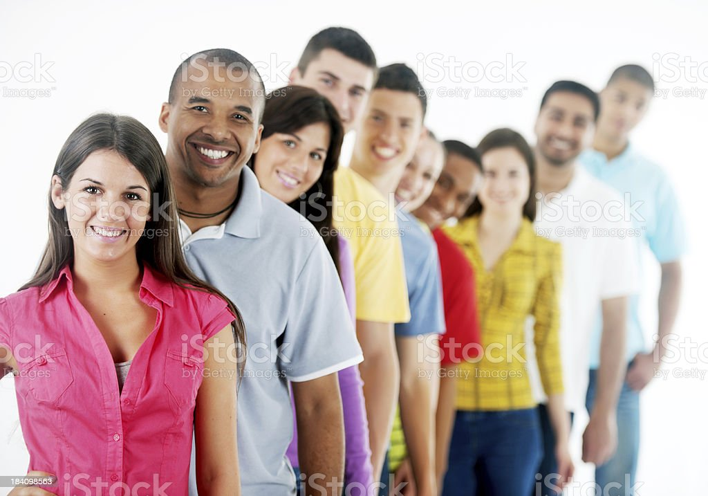 Group of young people standing in a row royalty-free stock photo