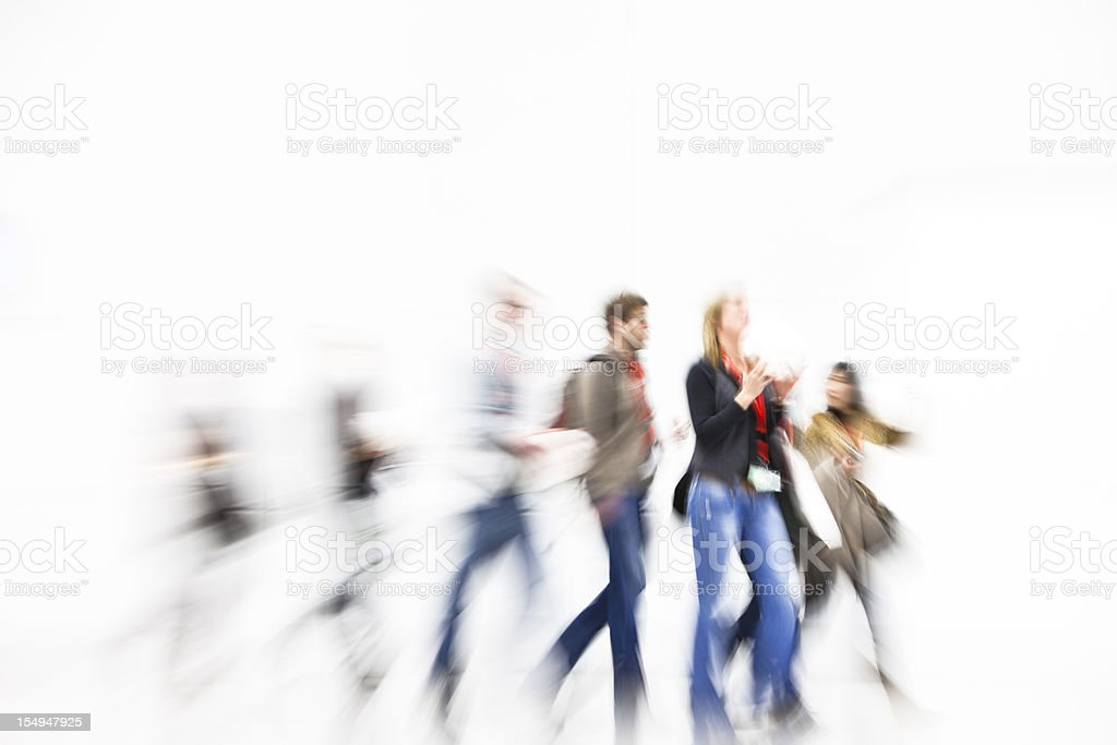 Group of young people walking and motion blurred royalty-free stock photo