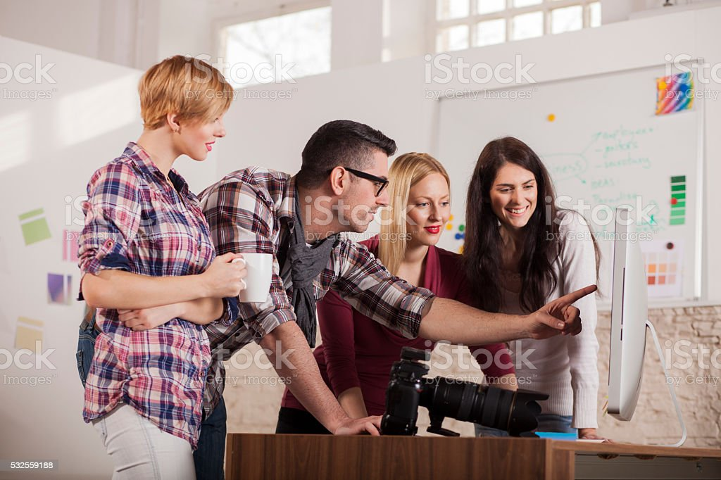 Group of young people working on a poject stock photo