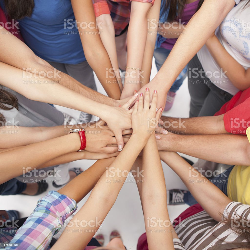 Group of young people's hands together. royalty-free stock photo