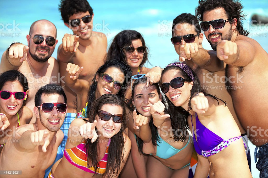 Group of young positive people pointing to camera royalty-free stock photo
