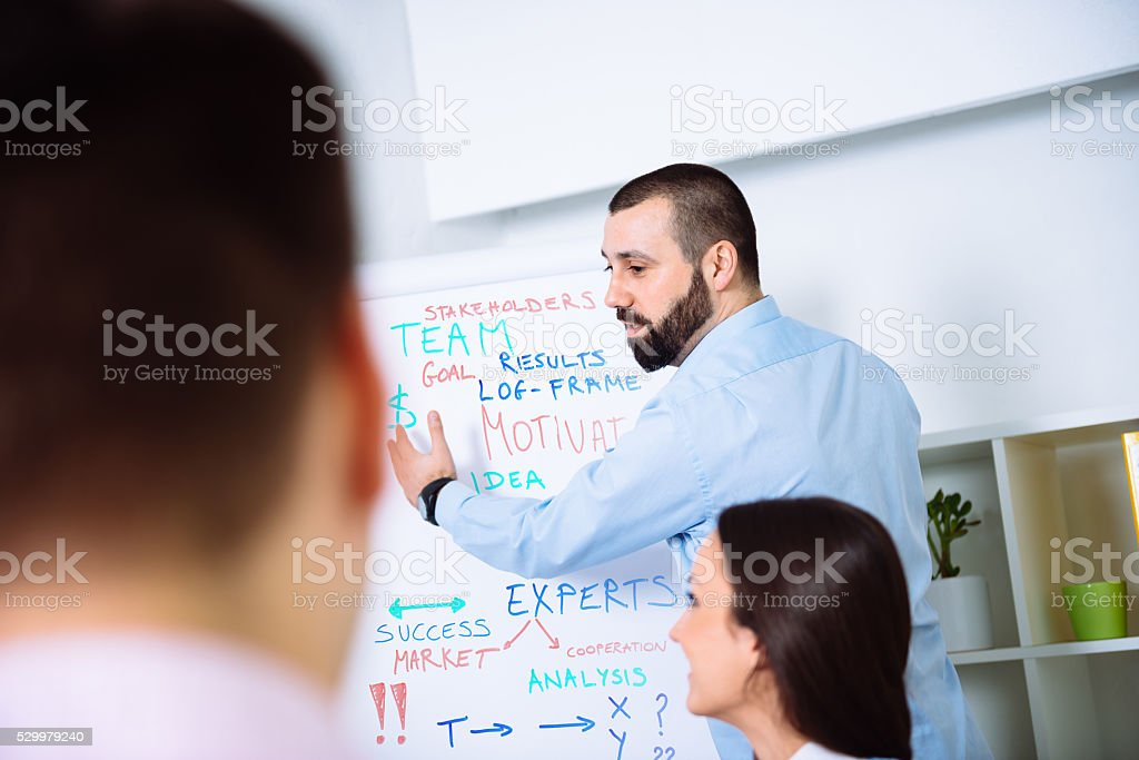 Group of young professionals on corporate workshop discussing business results stock photo