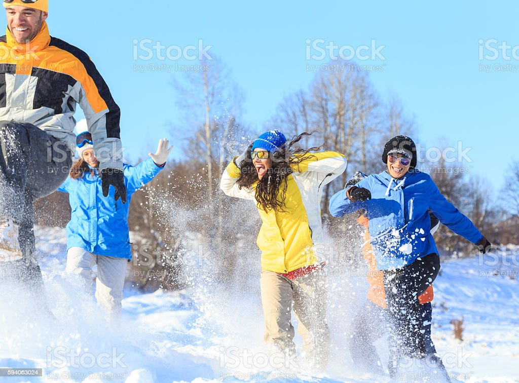 Group of young skiers having fun in the snow stock photo