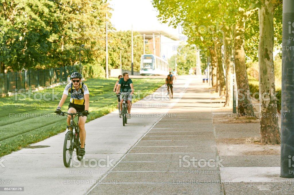 Group of young sportive boy riding bike on sunny day stock photo