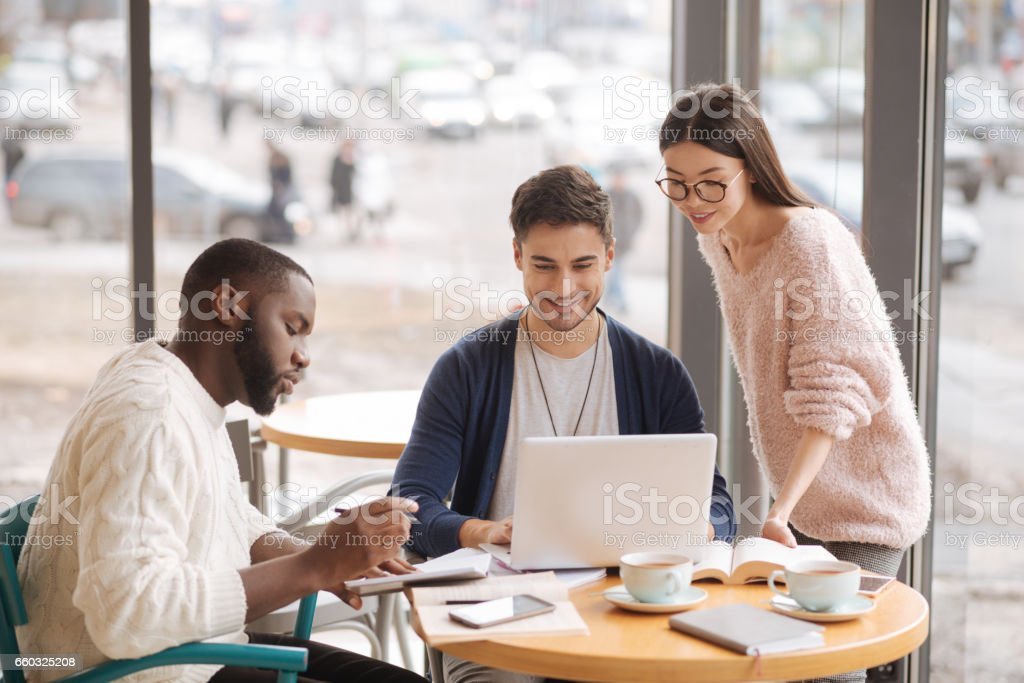 Group of young startupers brainstorming together stock photo
