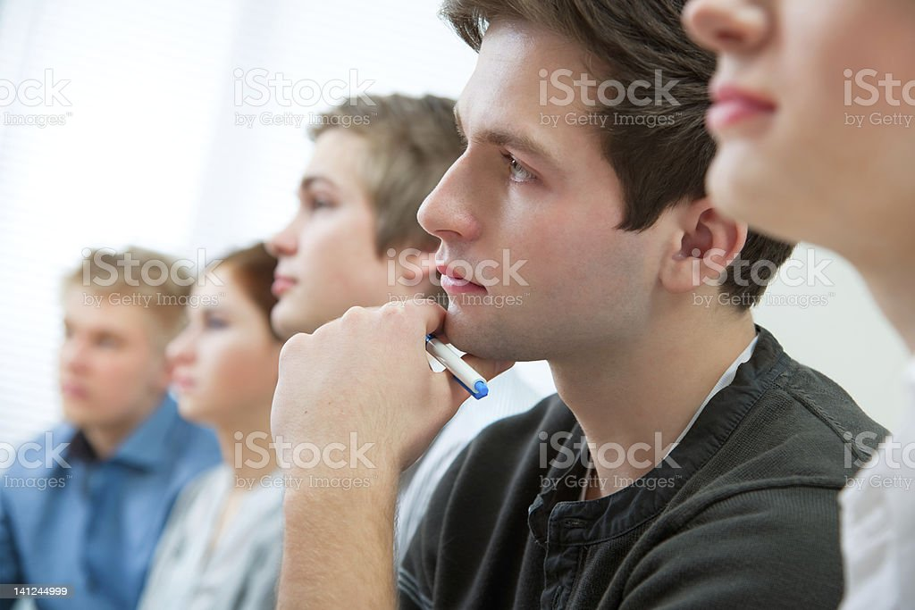 Group of young students listening and looking royalty-free stock photo