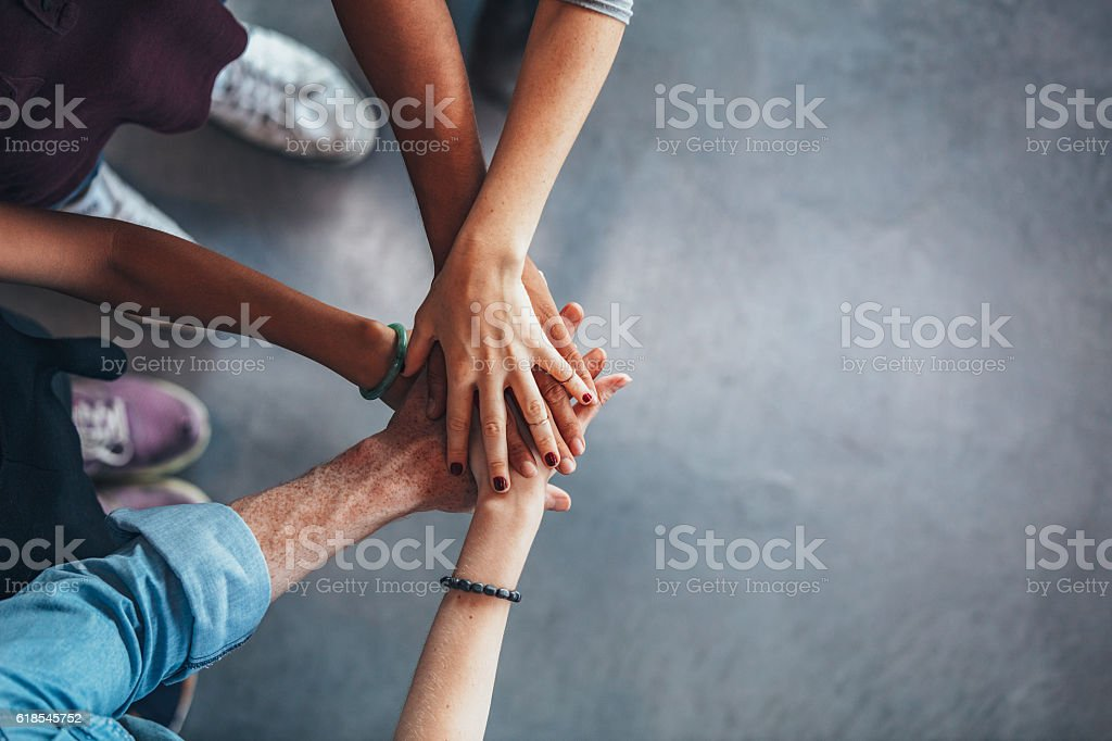 Group of young students showing unity stock photo