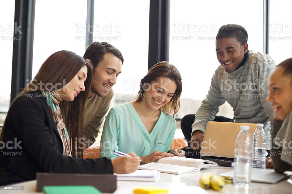 Group of young students studying in the library stock photo