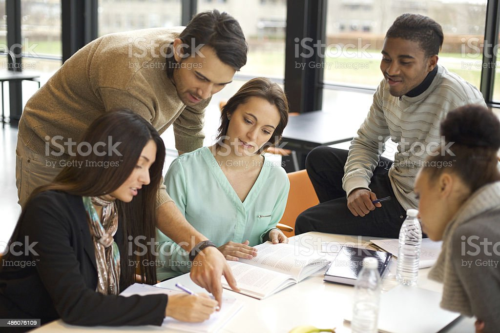 Group of young students studying together stock photo