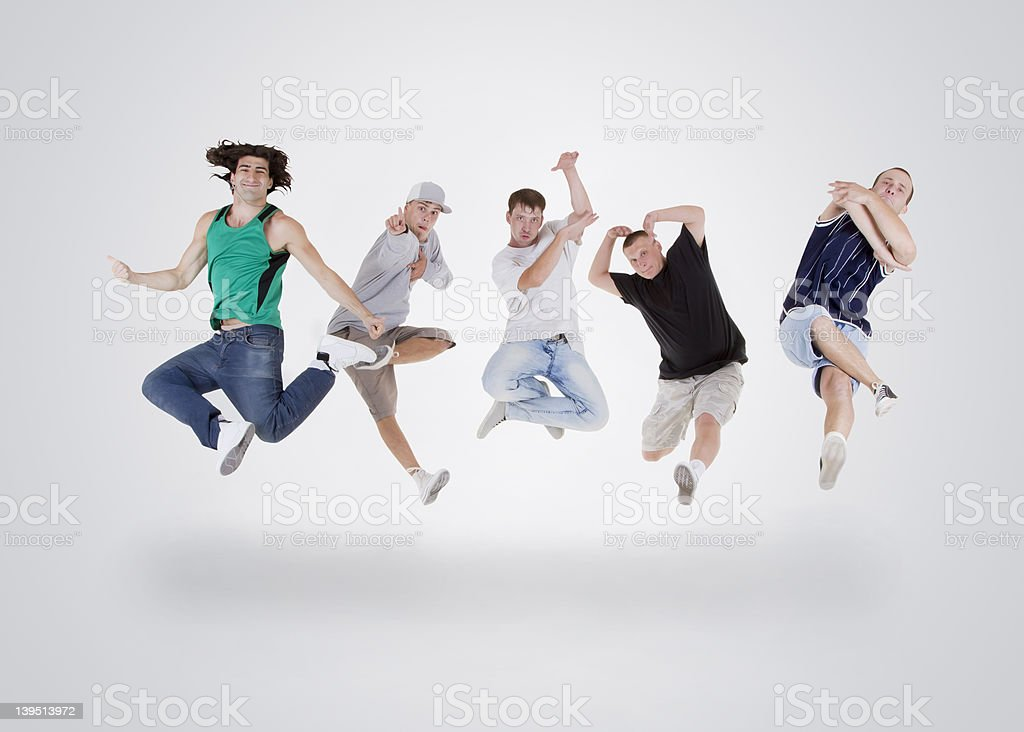 Group of young teenagers jumping over white royalty-free stock photo