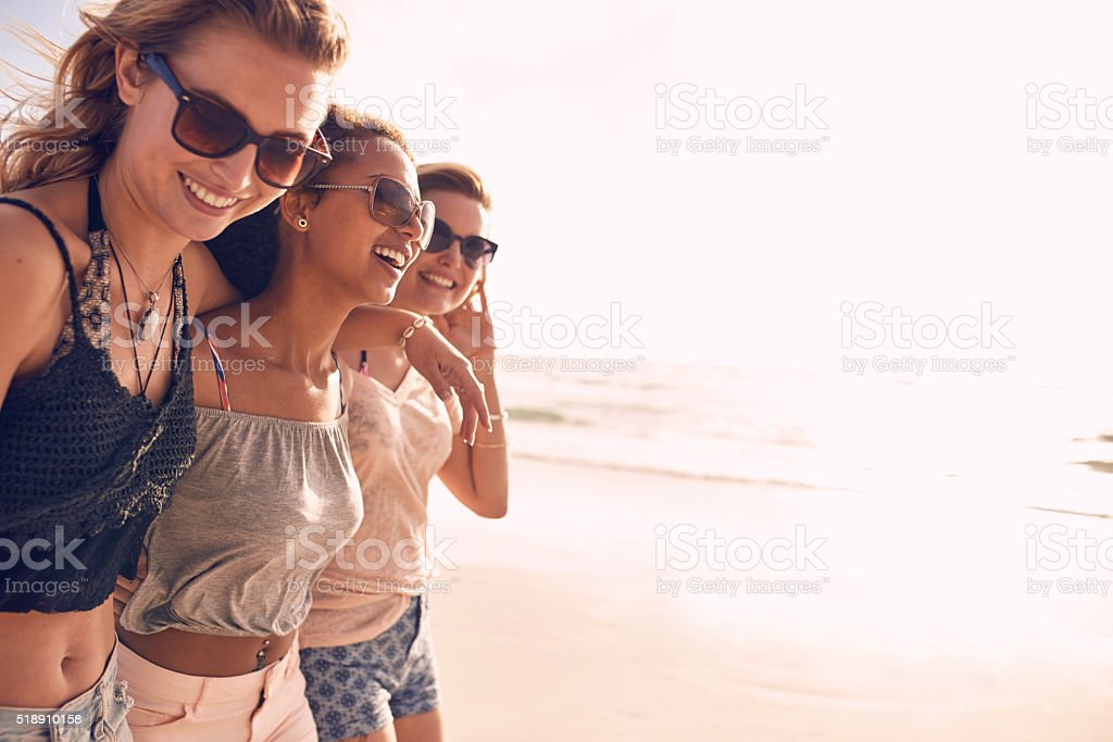 Group of young women enjoying vacation on beach stock photo