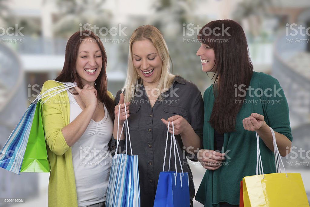 Group of young women shopping in a store stock photo