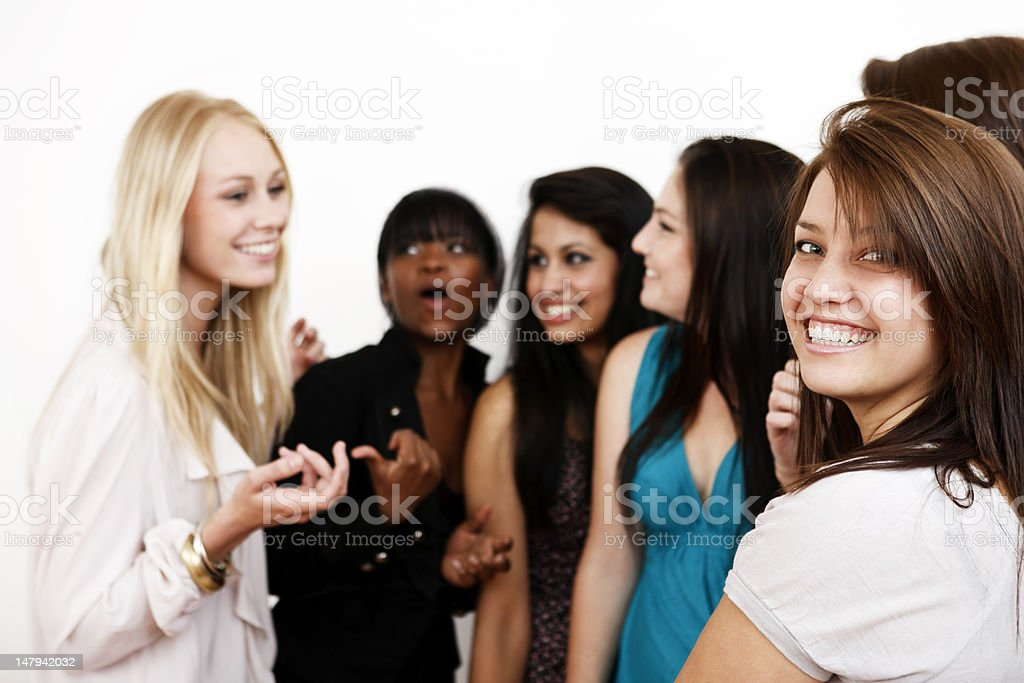 Group of young women smile and chat stock photo