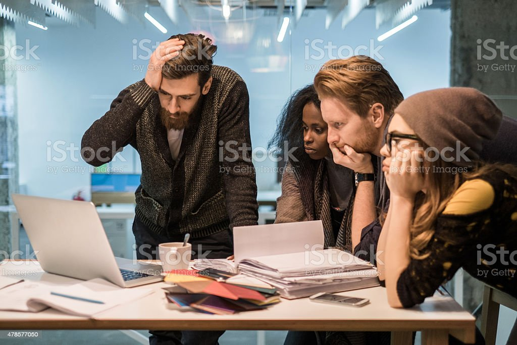 Group of young worried people having problems at work. stock photo