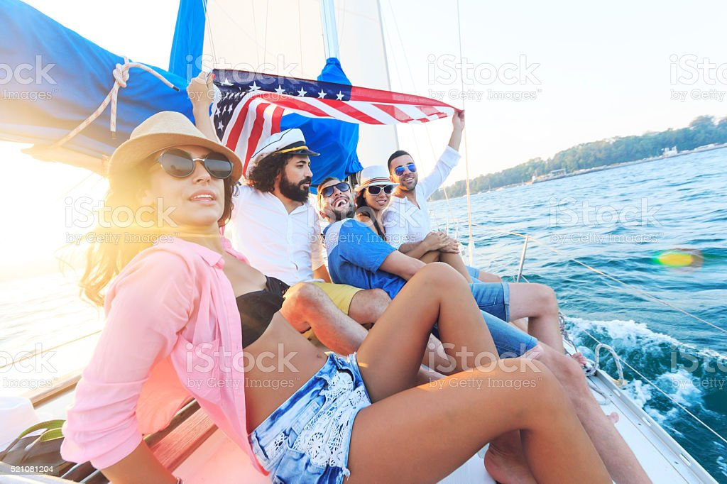 Group of yung people traveling with an yacht stock photo