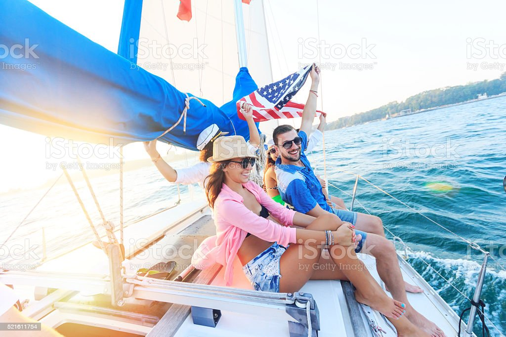 Group of yung people traveling with sailboat stock photo