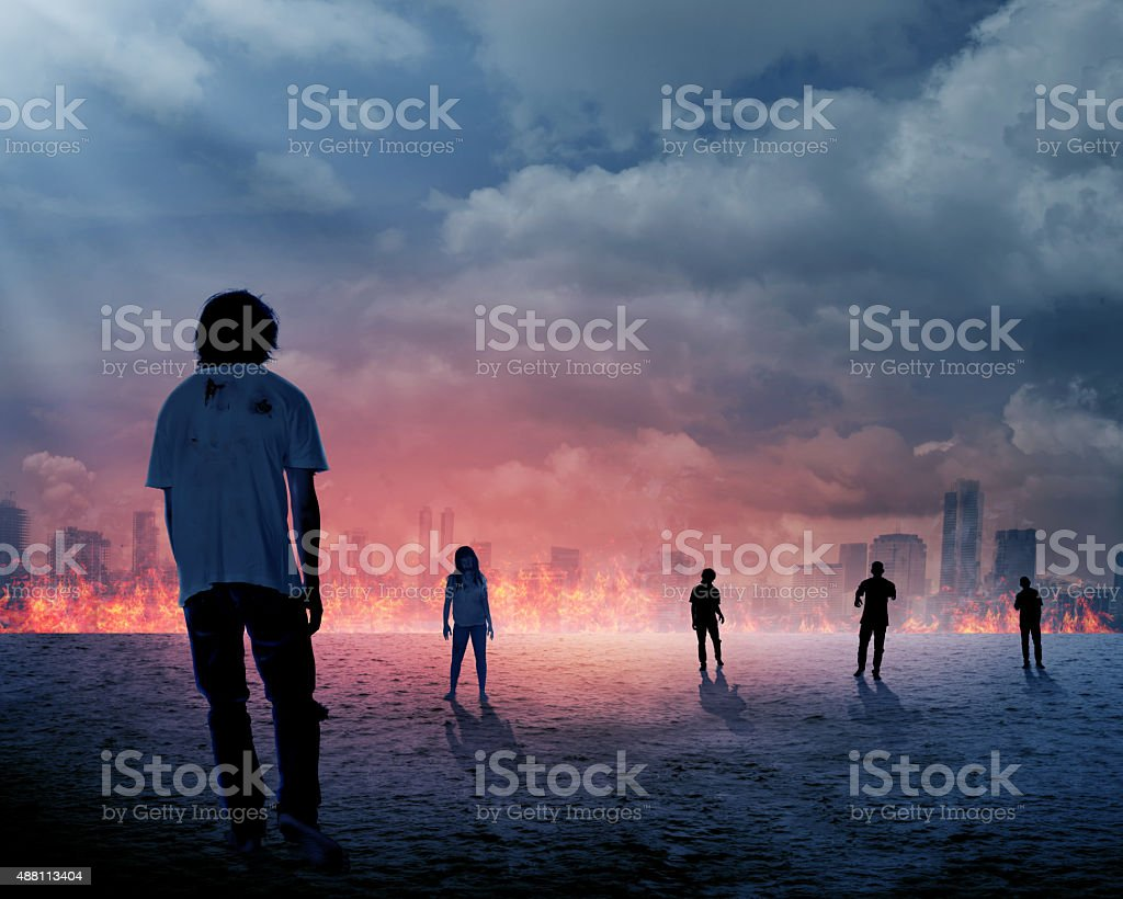 Group of zombie over burn city background stock photo