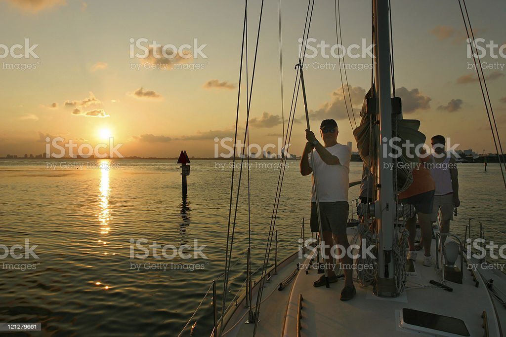 Group on Sailboat at sunset stock photo
