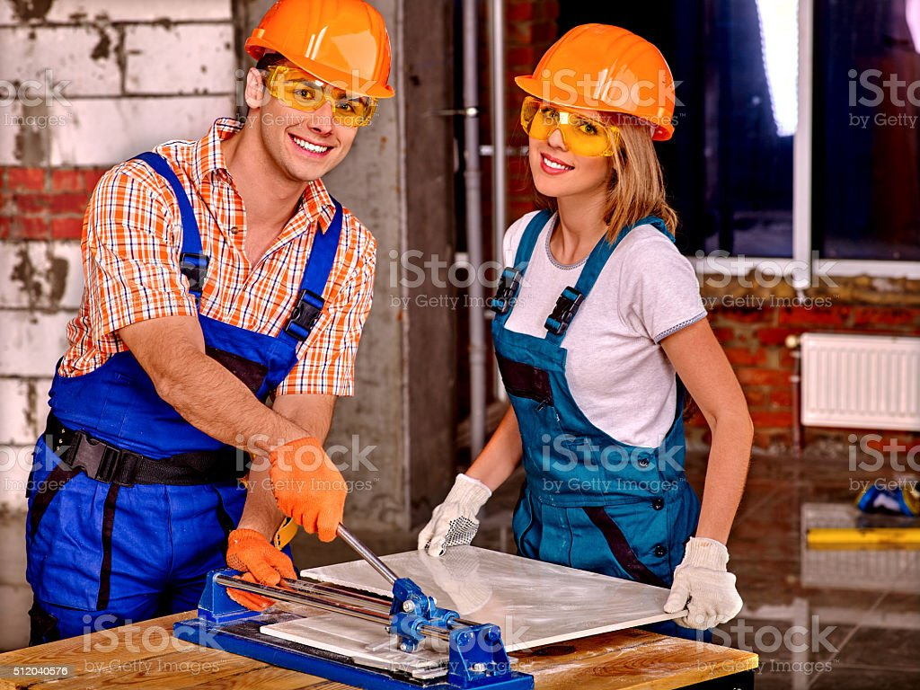 Group people builder cutting ceramic tile stock photo