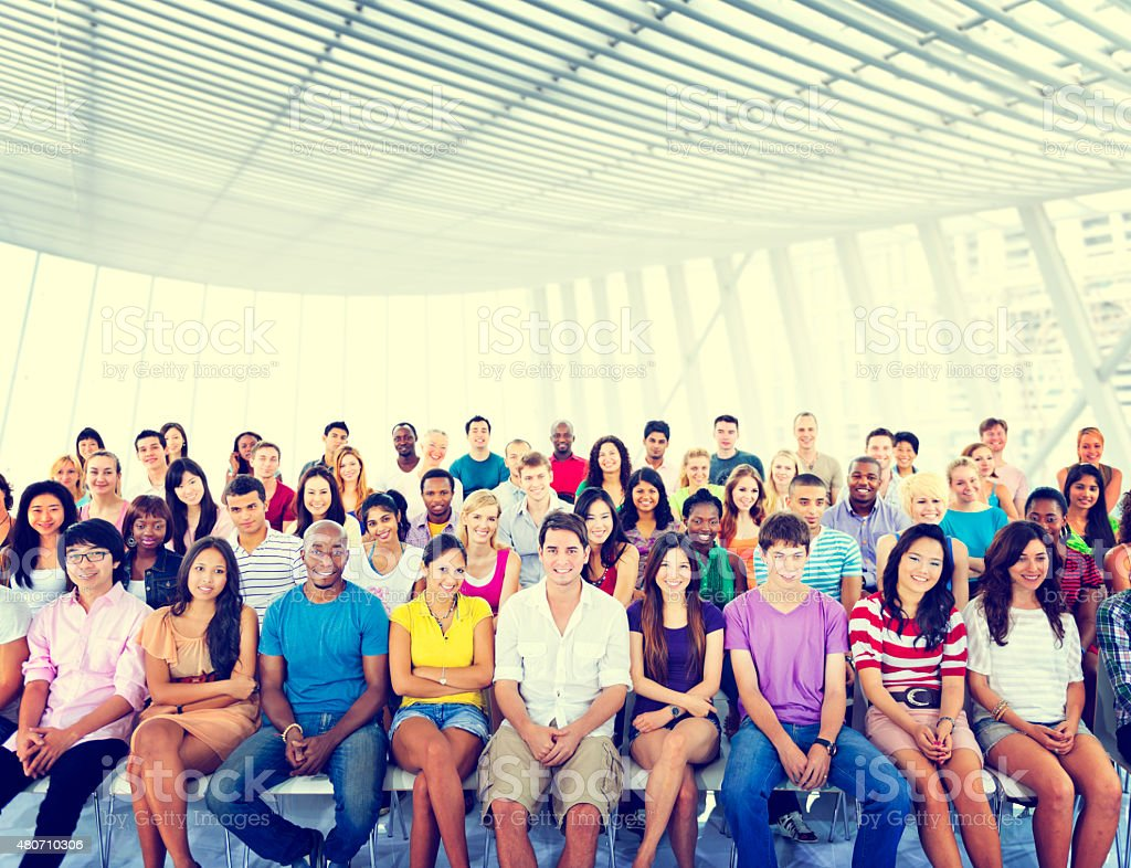 Group People Crowd Audience Casual Multicolored Sitting Concept stock photo