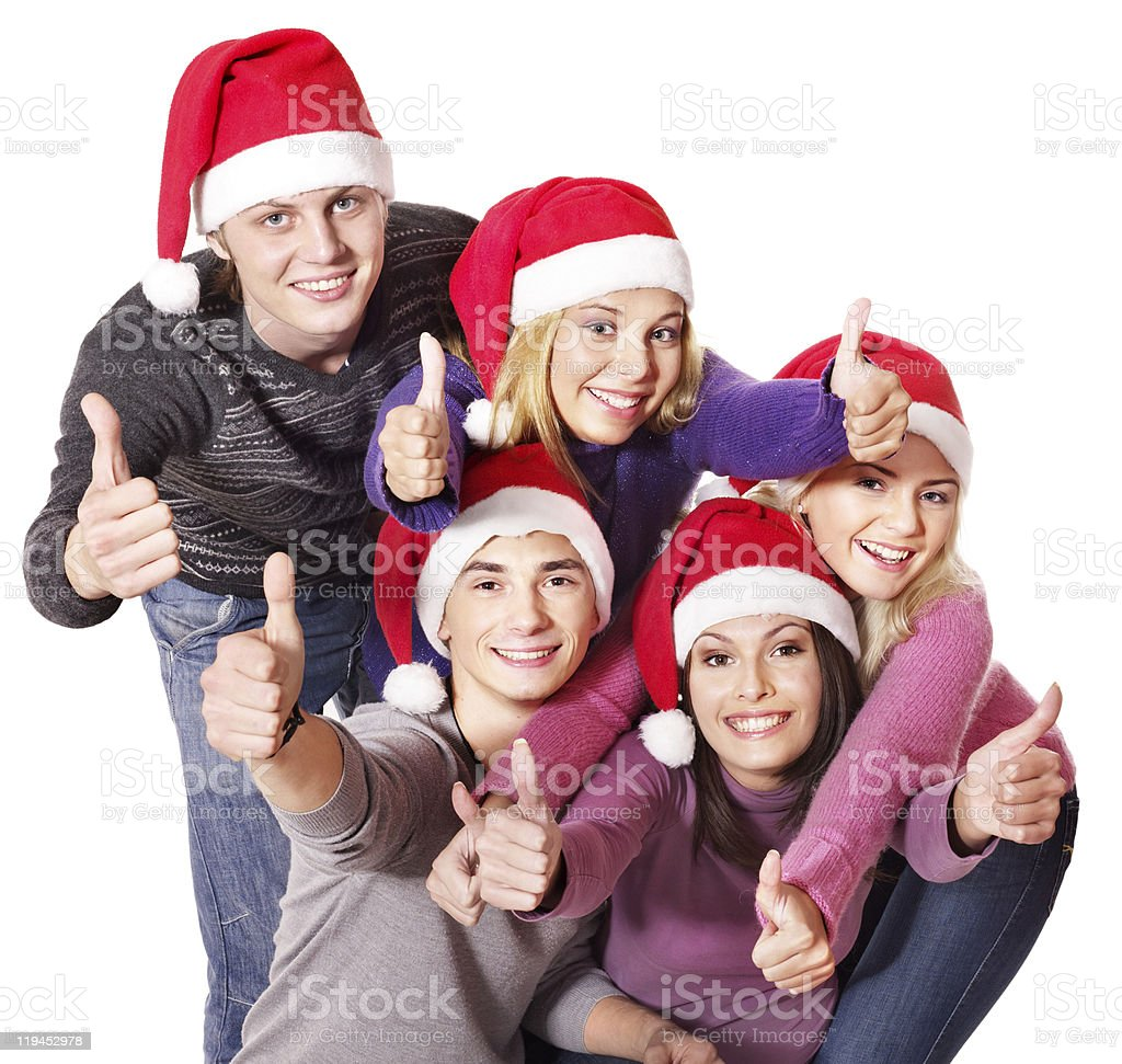 Group people in santa hat showing thumb up. stock photo