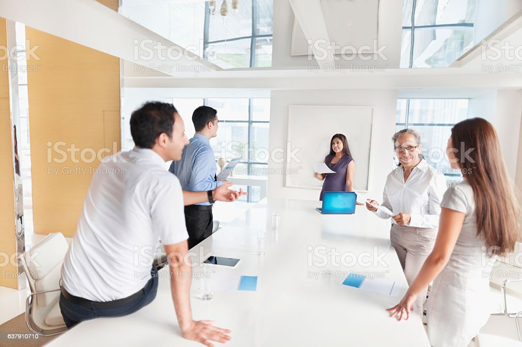 Group planning together in business conference room stock photo