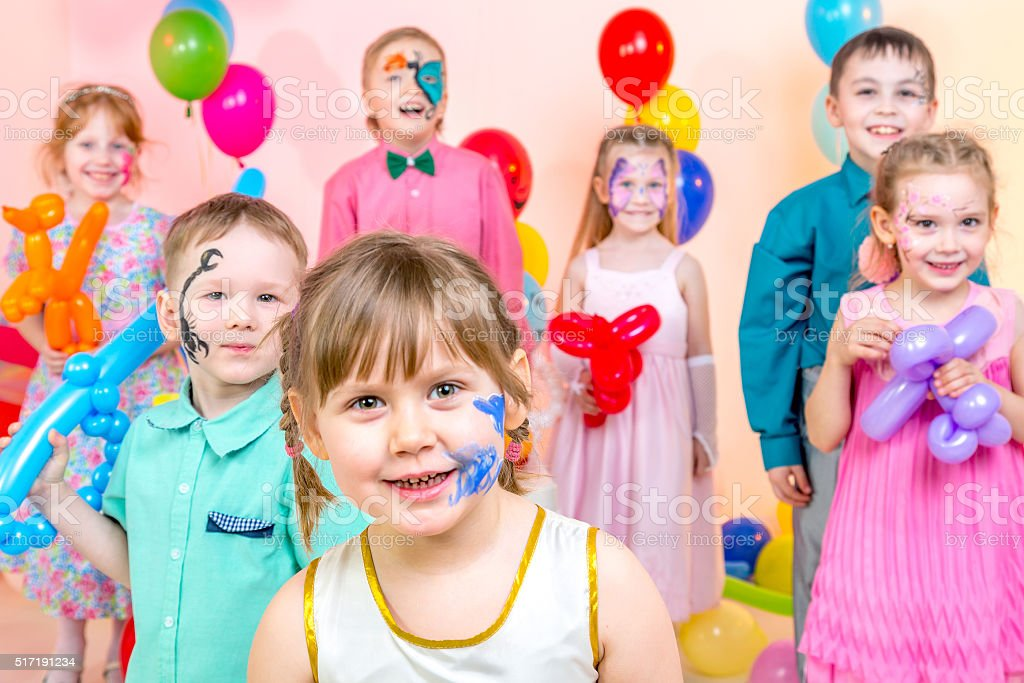 Group Portrait of Cheerful Kids at Children's Party stock photo