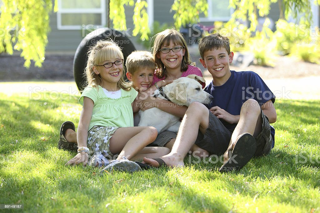 Group portrait of kids with dog royalty-free stock photo