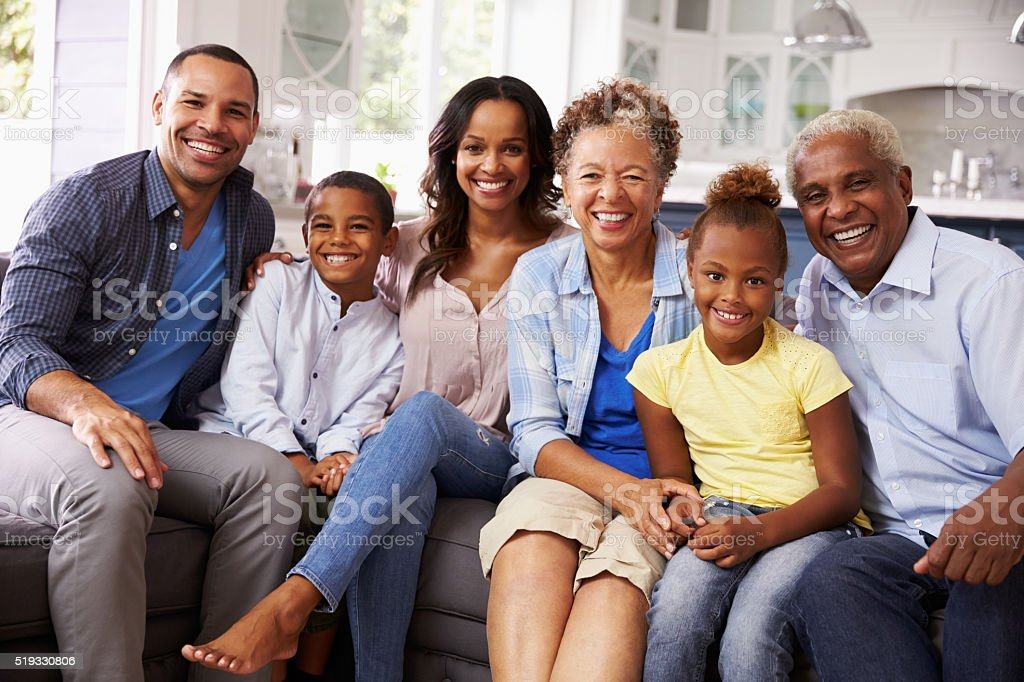 Group portrait of multi generation black family at home stock photo