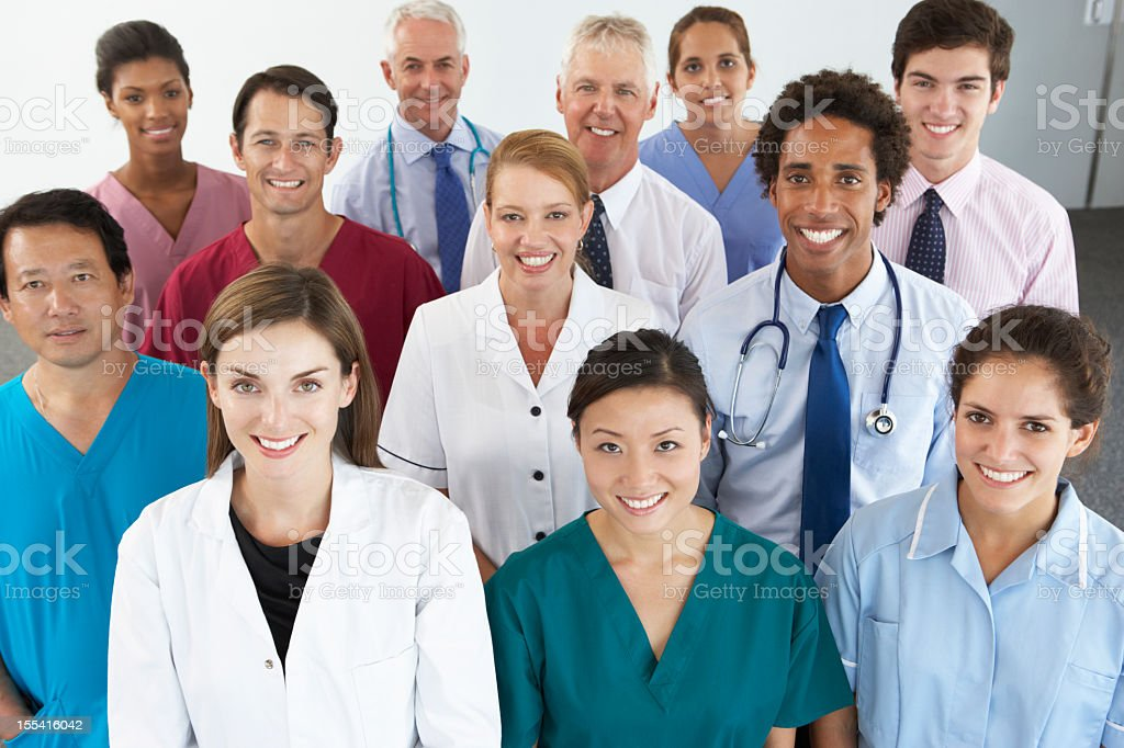 Group Portrait Of Workers In Medical Professions stock photo