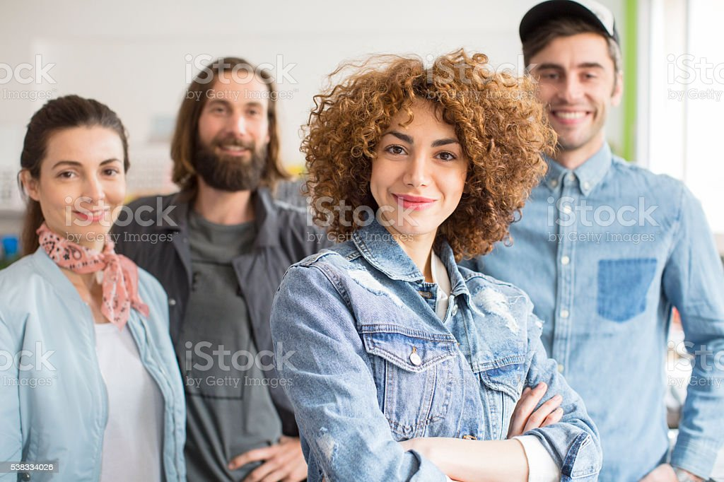 Group portrait of young creatives in their studio stock photo