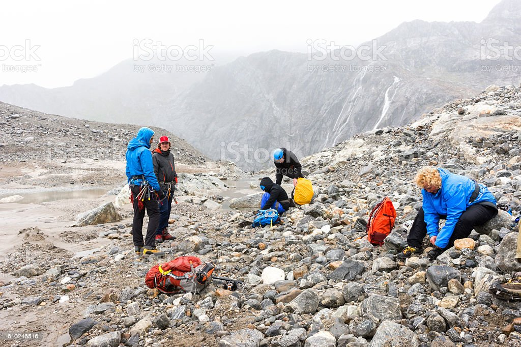 Group prepares for trekking adventure stock photo