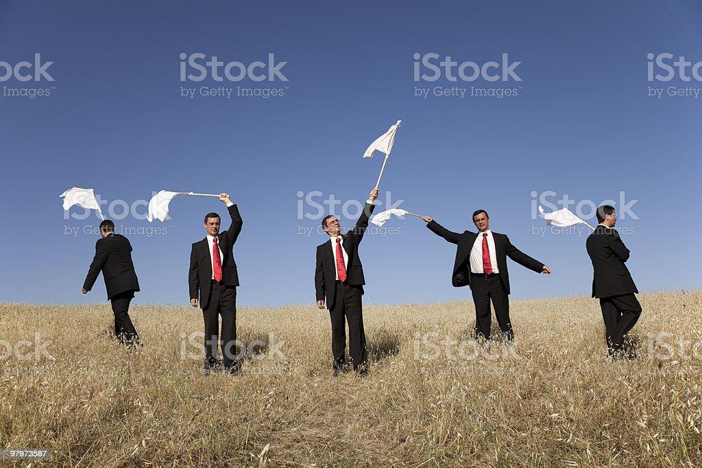 Group raising the white flag stock photo