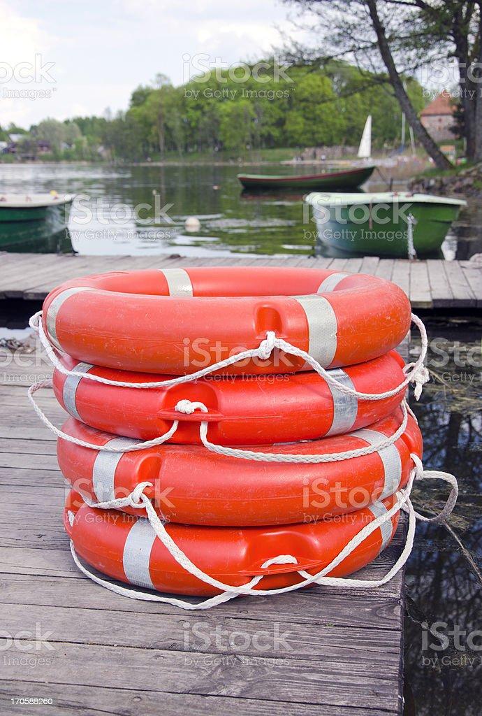 group red life buoy on lake bridge royalty-free stock photo