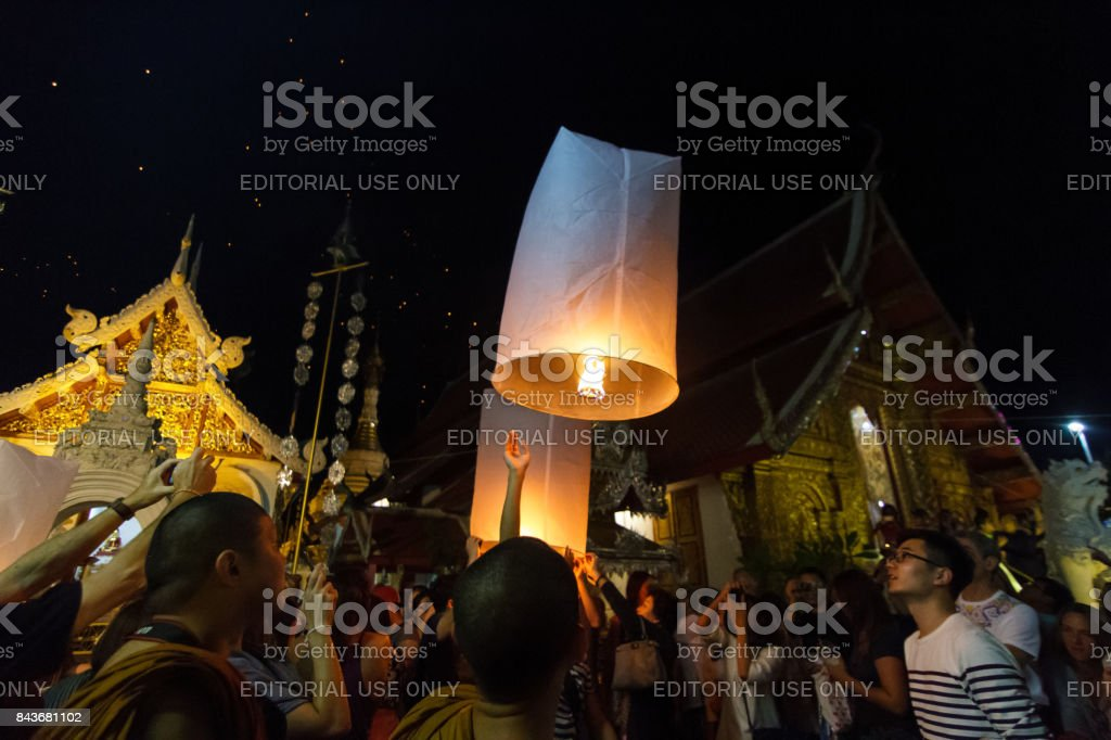 A group releases floating lanterns in Chiang Mai, Thailand stock photo