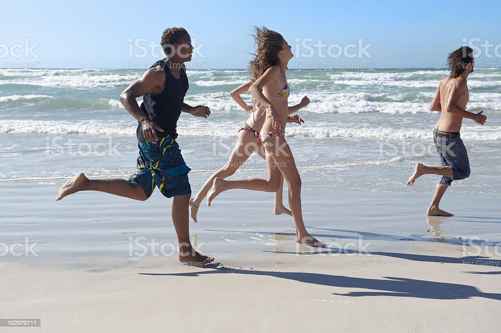 Group running on beach royalty-free stock photo