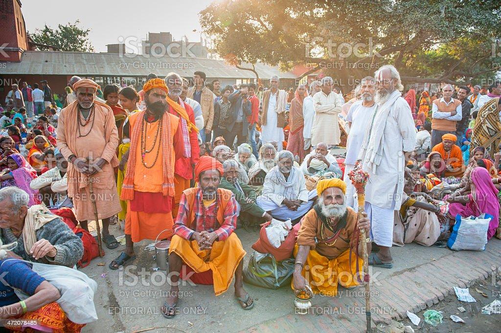 Group saddhu waiting on platform in railway station stock photo