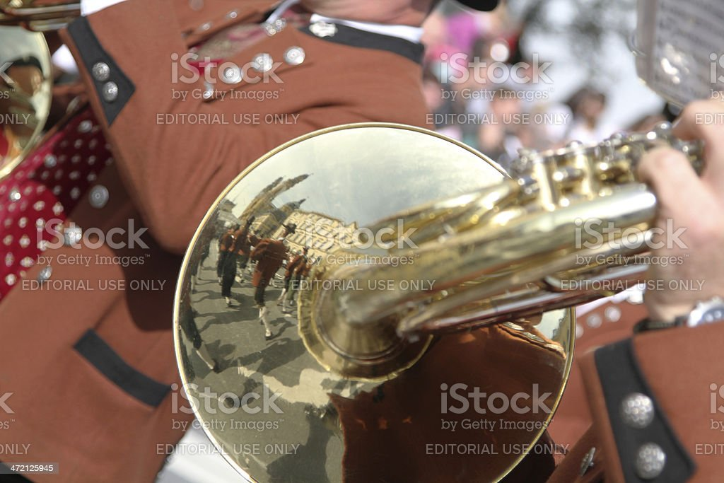 group seeham and theatinerkirche reflectet in brass oktoberfest stock photo