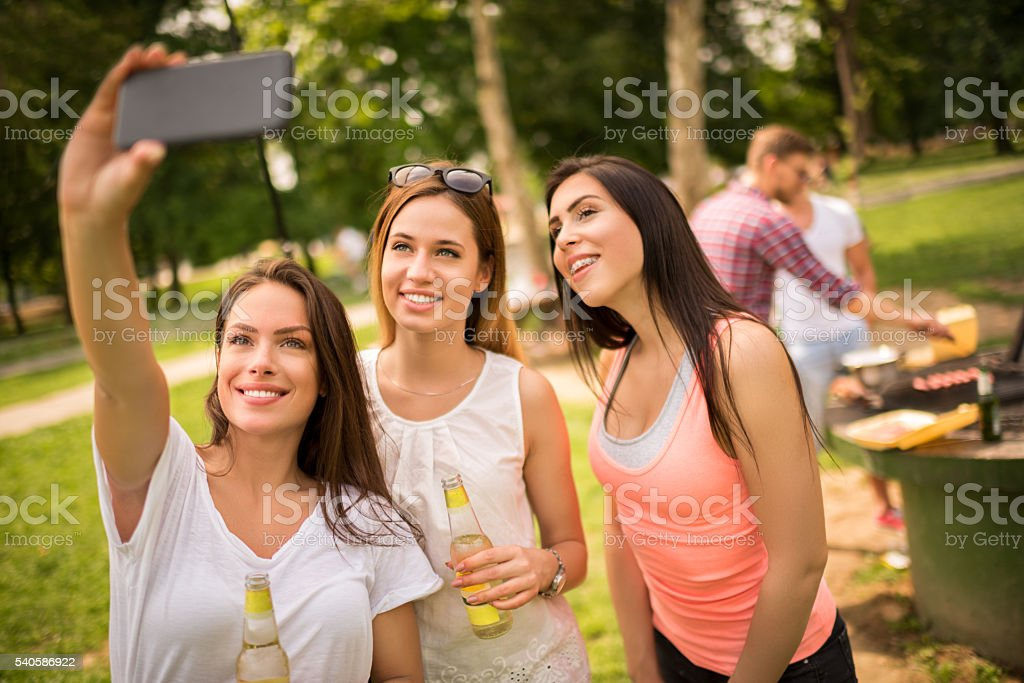 Group selfie during barbecue picnic stock photo