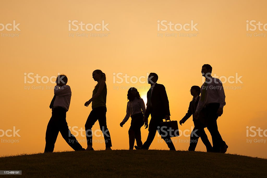A group shot of people walking forward  stock photo