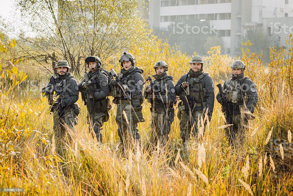 group soldiers stands and Looking At Camera stock photo