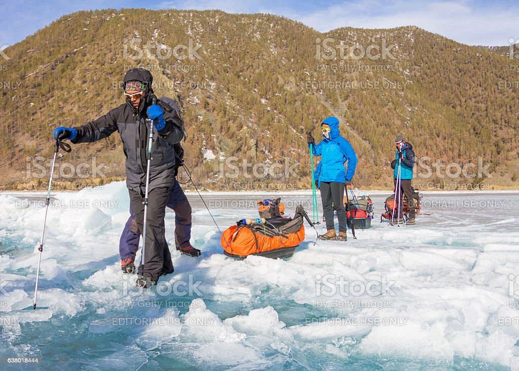 Lake Baikal, Russia - March 24, 2016: Group tourists Baikal stock photo
