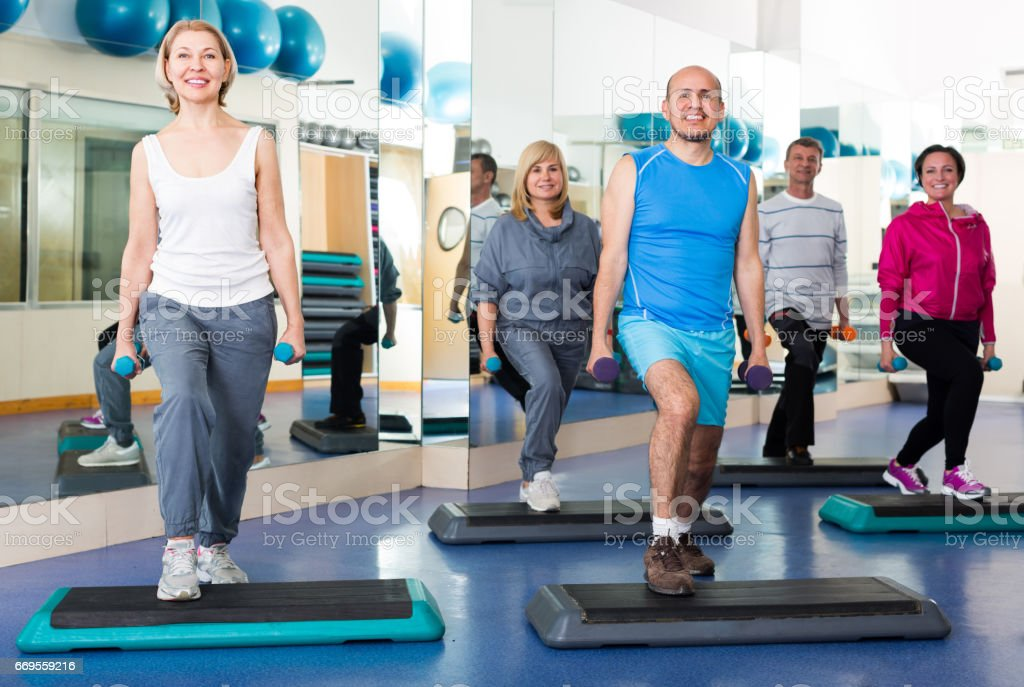 Group training in gym with dumbbells stock photo