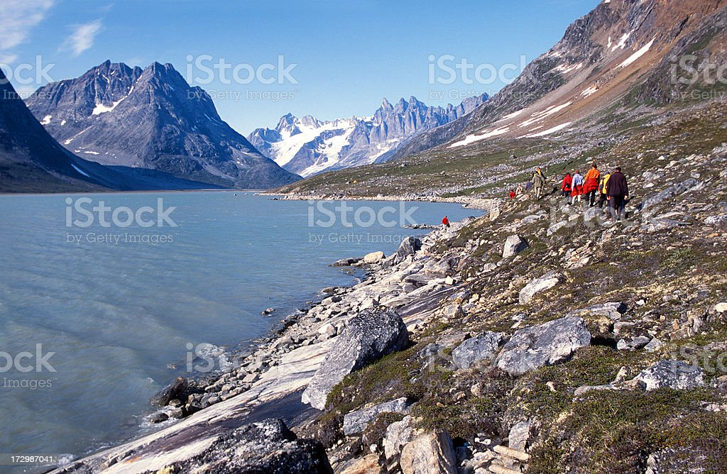 Group trekking through barren valley, Greenland royalty-free stock photo