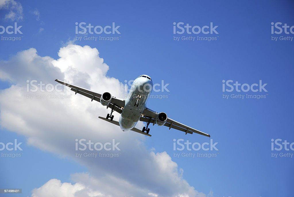 Group up view of a passenger airplane coming in to land royalty-free stock photo