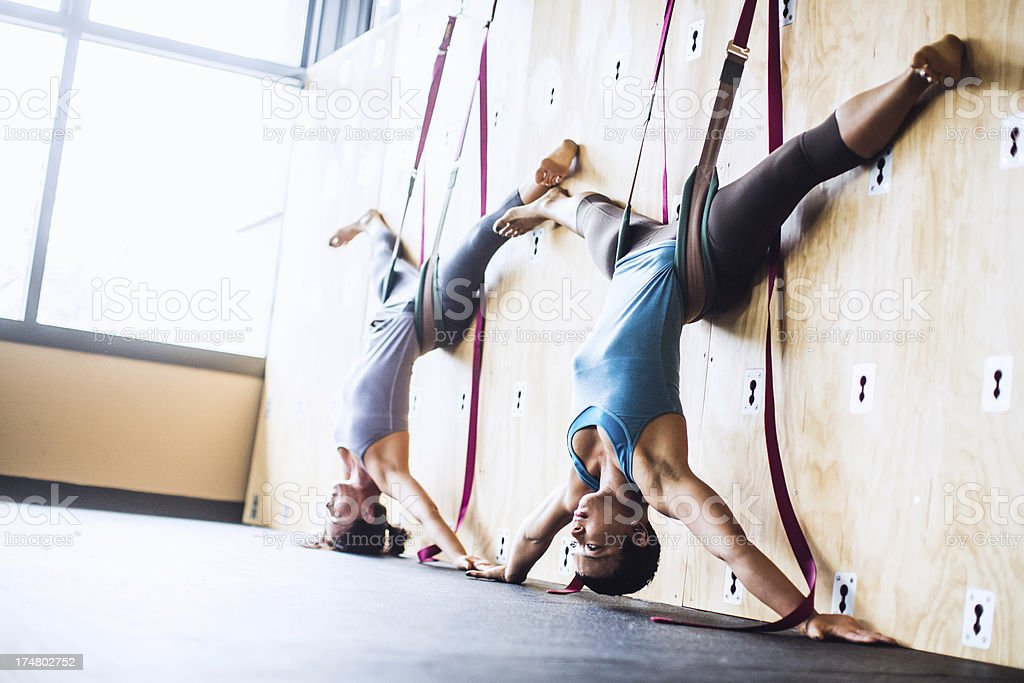 Group Wall Yoga Class stock photo