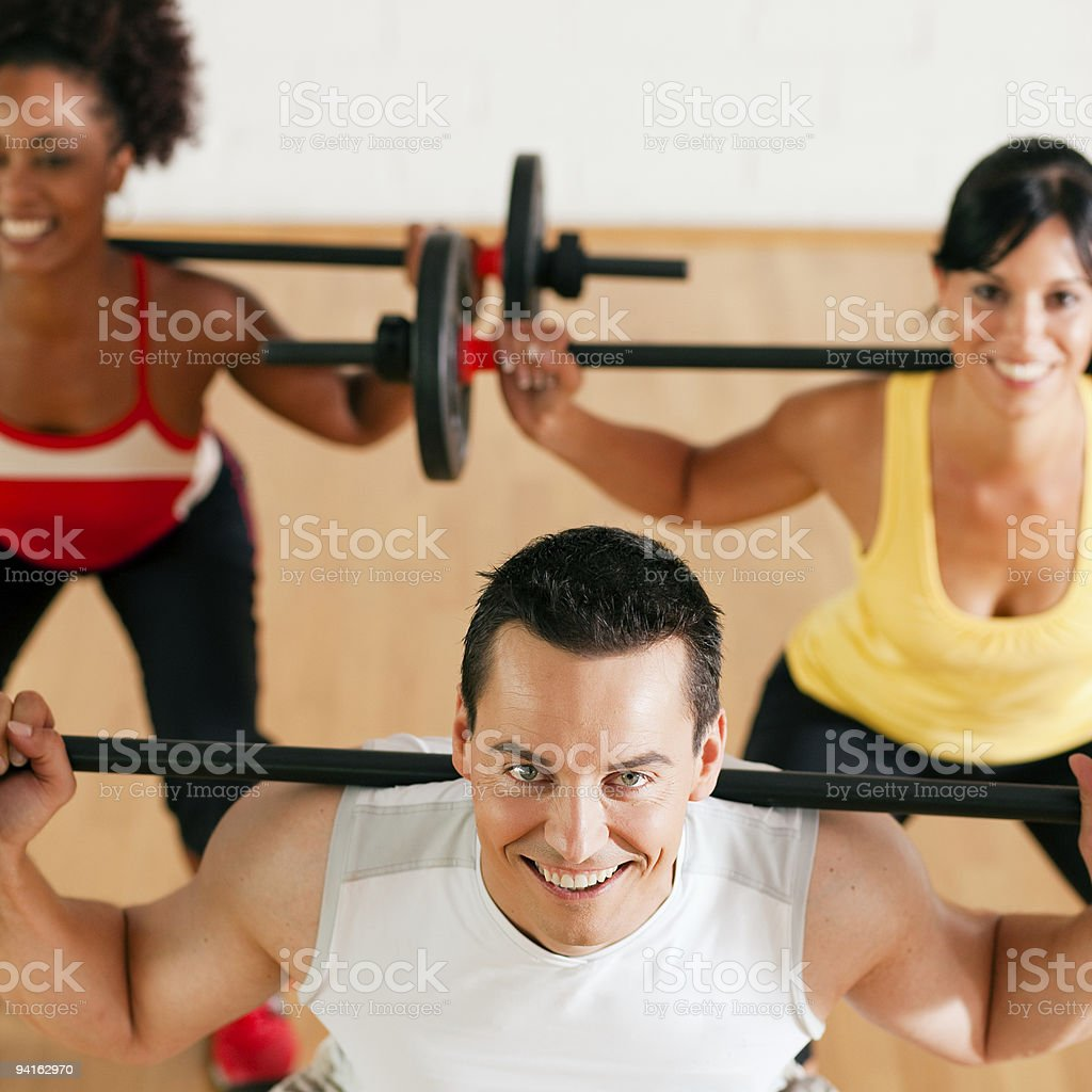 Group with barbell in gym royalty-free stock photo