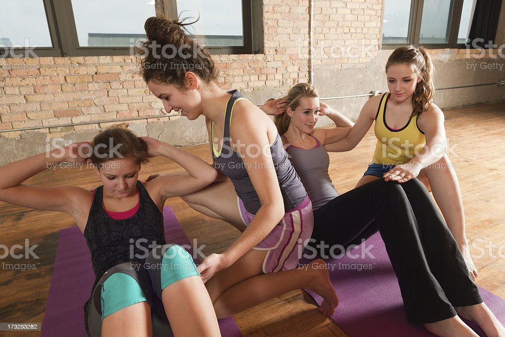 Group Workout Exercise Training with Help from Gym Trainer Hz stock photo