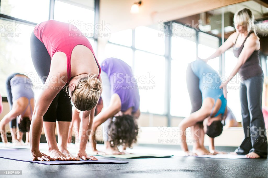 Group Yoga Class in Studio with Instructor stock photo
